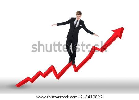 Full length of young businessman balancing on growing line graph over white background - stock photo