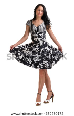 Full length of young elegant female in fashion dress, over white background