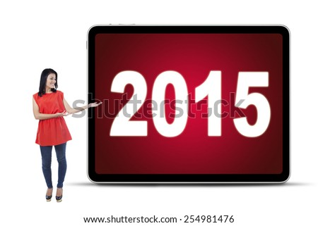 Full length of young woman standing in the studio and showing numbers 2015 on the billboard - stock photo