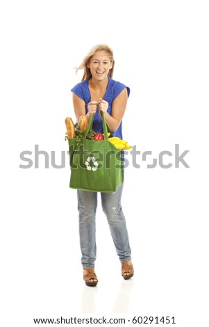Full length of young woman with green recycled grocery bag - stock photo