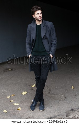Full-length outdoor fashion male portrait - stock photo