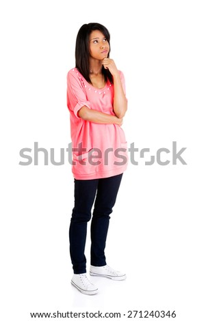 Full length pensive woman with hand under chin. - stock photo