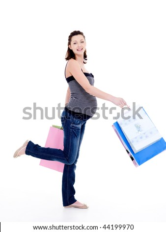 Full-length photo of a Beautiful happy pregnant woman walking after shopping - stock photo