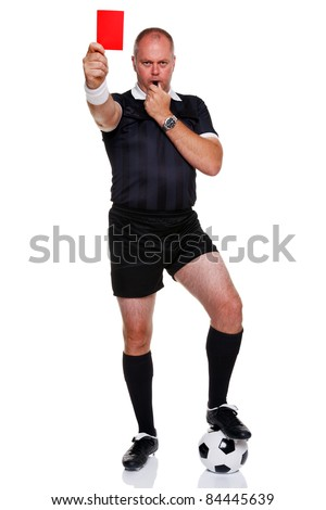 Full length photo of a football or soccer referee showing you the red card for a sending off, isolated on a white background. - stock photo