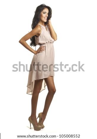 Full length photo of beautiful woman wearing elegant dress.  Image isolated against white background. - stock photo