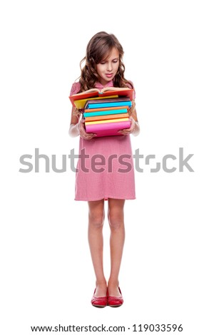 full length photo of concentrated girl reading the book. isolated on white background - stock photo