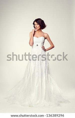 full-length photo of young bride in long white dress - stock photo