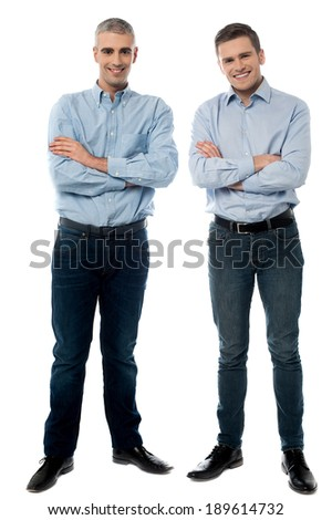 Full length picture of a casual men, arms folded - stock photo