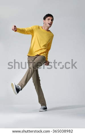 full length picture of a casual young man posing
