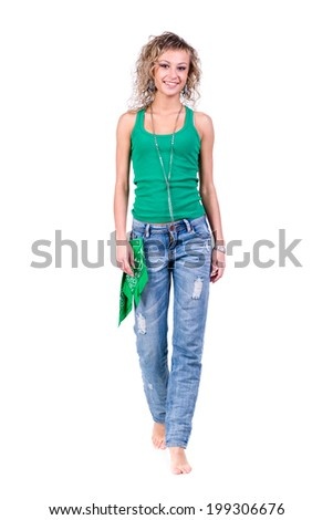 full length picture of a casual young woman standing, isolated on white background - stock photo