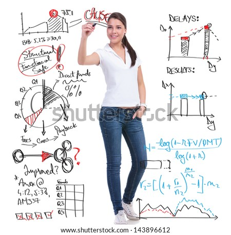 full length picture of a casual young woman writing calculations and graphs while holding her other hand in the pocket. isolated on white background - stock photo