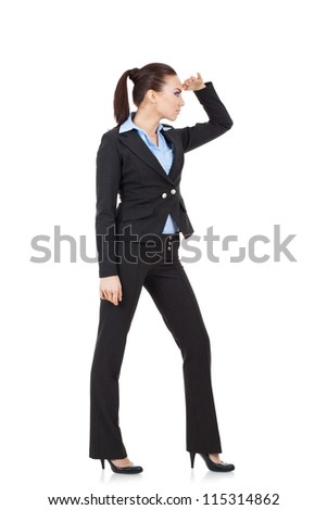 full length picture of a young business woman looking far away, over a white background - stock photo