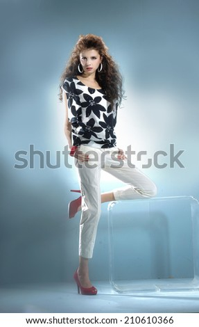 Full length portrait fashion model standing posing on light background - stock photo