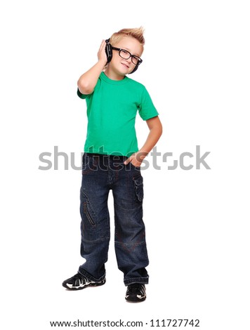 Full length portrait if a stylish boy in headphones - stock photo