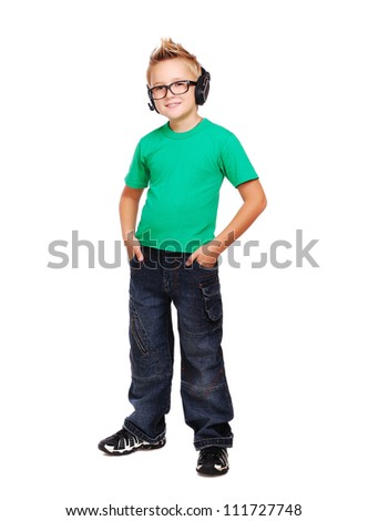 Full length portrait if a stylish boy in headphones