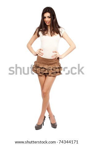 Full length portrait of a beautiful alluring hispanic young woman isolated on white - stock photo