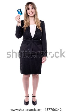 Full length portrait of a beautiful business woman holding debit card - stock photo