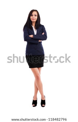 Full length portrait of a beautiful latin businesswoman standing with crossed arms and legs isolated on white background - stock photo