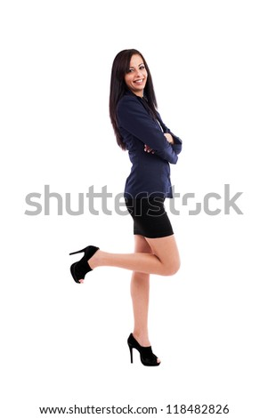 Full length portrait of a beautiful latin businesswoman standing with crossed arms isolated on white background - stock photo