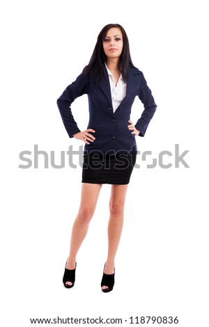 Full length portrait of a beautiful latin businesswoman standing with hands on hips isolated on white background - stock photo