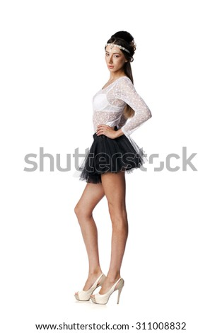 Full length portrait of a beautiful slim brunette model in black skirt and white blouse transparent, on white isolated background