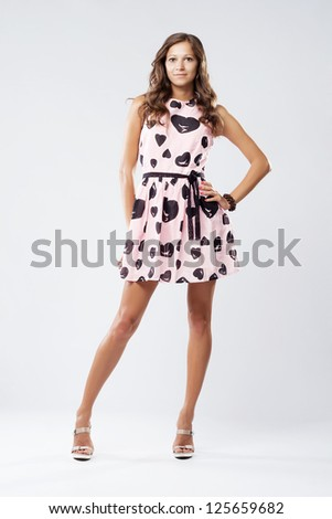Full-length portrait of a beautiful woman in romantic dress - stock photo