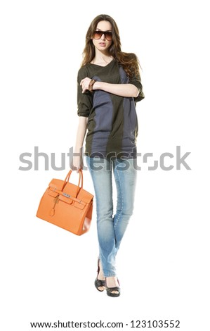 Full length portrait of a beautiful woman with bag isolated - stock photo