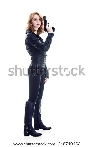 Full length portrait of a beautiful young woman holding a gun.  Isolated on white. - stock photo