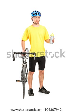 Full length portrait of a bicyclist posing next to a bicycle and holding a bottle isolated on white background - stock photo