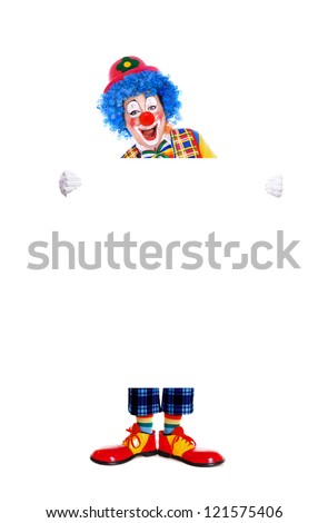 Full length portrait  of a birthday clown holding the blank board - stock photo