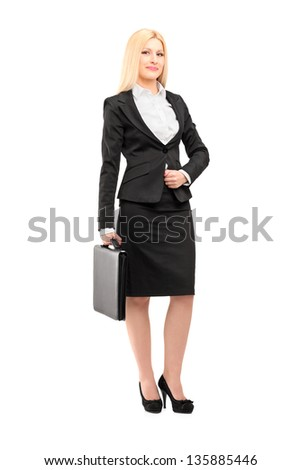 Full length portrait of a blond businesswoman holding a suitcase isolated against white background - stock photo