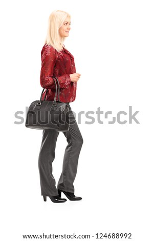 Full length portrait of a blond woman standing isolated on white background - stock photo