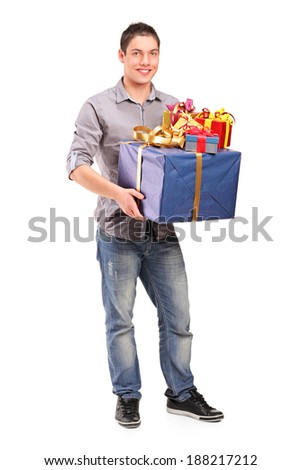 Full length portrait of a boy holding a big gift isolated against white background