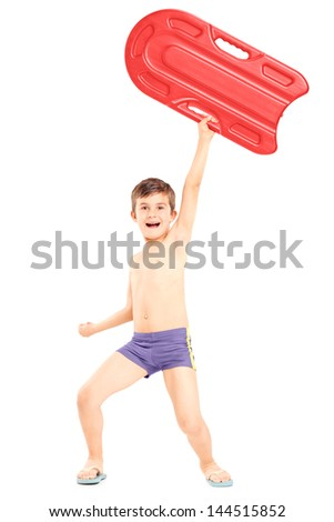 Full length portrait of a boy holding a swimming float and gesturing happiness, isolated on white background - stock photo