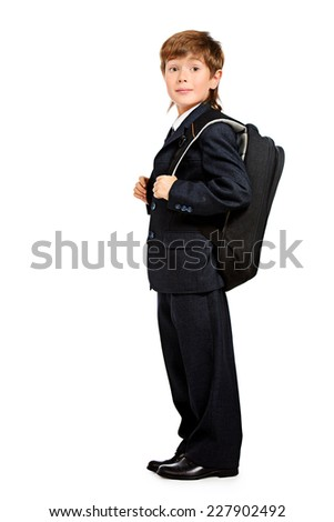 Full length portrait of a boy in a formal suit with schoolbag. Education. Copy space. Isolated over white. - stock photo