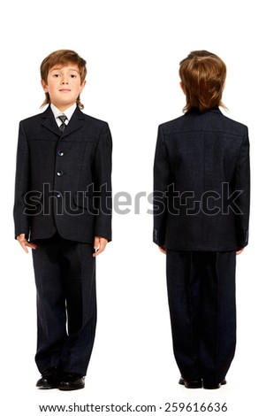Full length portrait of a boy in a suit, school uniform. Education. Copy space. Isolated over white. - stock photo