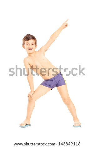 Full length portrait of a boy in swimming shorts gesturing with his hand isolated on white background - stock photo