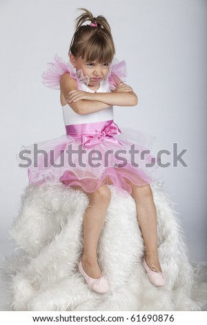 Full length portrait of a brat little ballerina crossing her arms, studio image