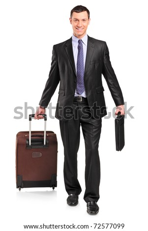Full length portrait of a business traveler carrying a suitcase isolated against white background - stock photo