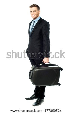 Full length portrait of a businessman holding briefcase - stock photo