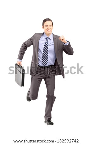 Full length portrait of a businessman running with a briefcase and looking at camera isolated on white background - stock photo