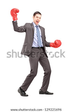 Full length portrait of a businessman wearing red boxing gloves and gesturing happiness isolated on white background - stock photo