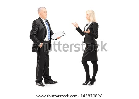 Full length portrait of a businesswoman explaining an idea to her boss isolated on white background - stock photo