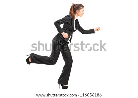 Full length portrait of a businesswoman in hurry running isolated on white background - stock photo