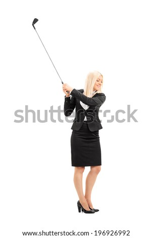 Full length portrait of a businesswoman swinging a golf club isolated on white background - stock photo