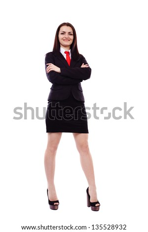 Full length portrait of a businesswoman with crossed arms isolated on white background