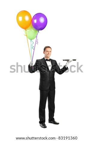 Full length portrait of a butler holding an empty tray and balloons isolated on white background - stock photo