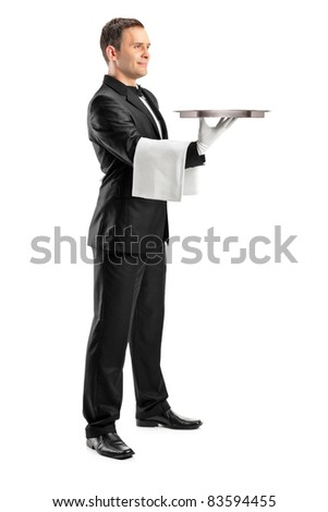 Full length portrait of a butler with bow tie carrying an empty tray isolated against white background