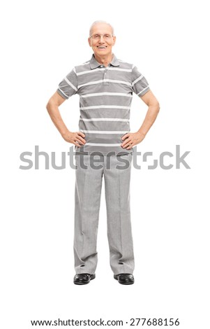 Full length portrait of a casual senior in gray pants and polo shirt, smiling and looking at the camera isolated on white background - stock photo
