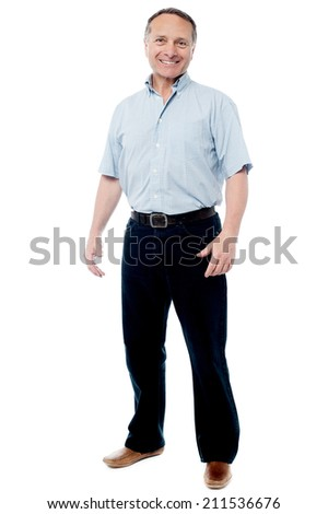 Full length portrait of a casual senior man standing - stock photo